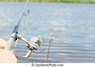 Angler fishing with a rod and spinning reel
