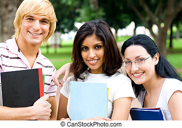 college students - happy college students with textbooks in...