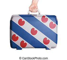 Used plastic suitcase with stains and scratches, printed...