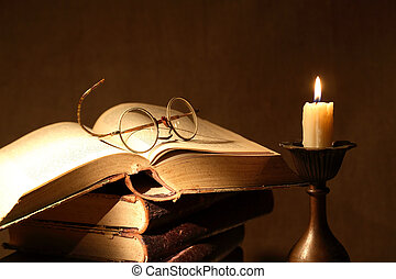 Books And Candle - Vintage still life with old books and...