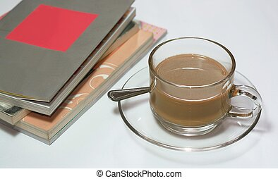 books and cup of coffee on white background