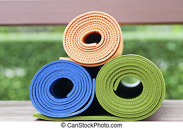 yoga mats - Colorful yoga mats set in order