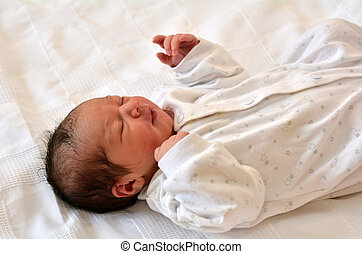Newborn baby - Little newborn baby 1day old seelp on its...
