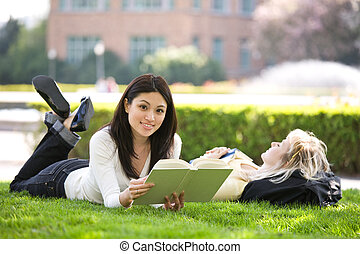 Studying college students - A shot of two college students...