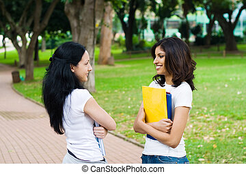 college friends - students talking to each other in park