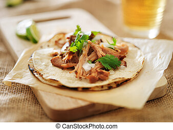 authentic mexican tacos with carnitas, cilantro and onion