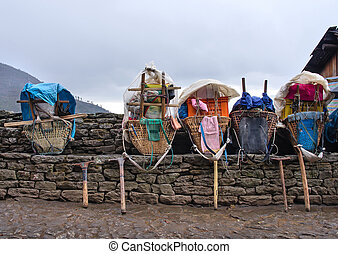 Heavy loads of porters  in the Himalaya Mountains, Nepal