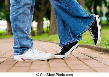 tip-toe kiss - standing on her tip-toes to kiss her...