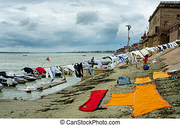 washing clothes in the Ganges River In Varanasi, India -...