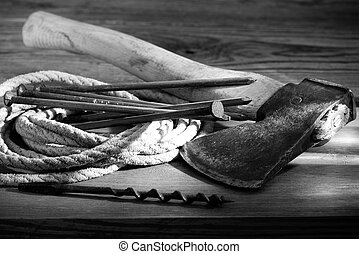 Hatchet - still life with a hatchet and old tools