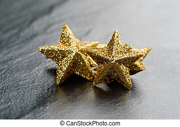 Golden sparkling stars - Golden sparkling glitter stars on...