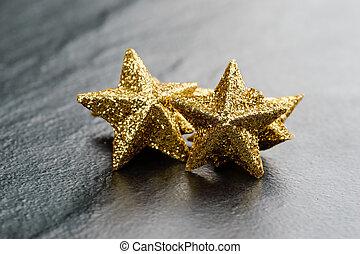 Golden sparkling stars - Golden sparkling glitter stars on...