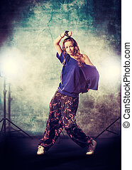 performer - Modern hip-hop dancer over grunge background