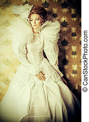 couture - Beautiful fashion model in the refined white dress...