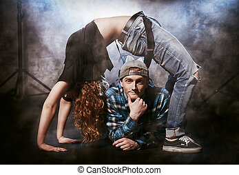 freestyle - Two modern dancers over grunge background....