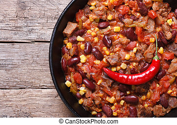 chili con carne close-up in a frying pan top view - chili...