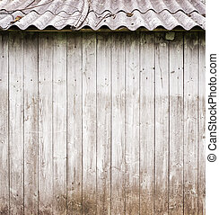 grey wooden plank wall withe a roof