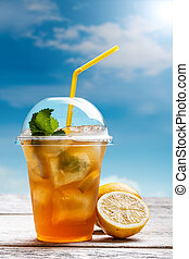Lemon ice tea - Plastic glass of lemon ice tea