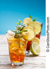 Iced tea - Summer iced tea with lemon, ice cube and mint