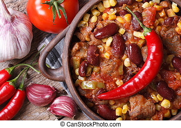 hot chili con carne in a pot macro top view - hot chili con...