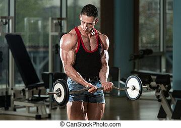 Muscular Man Exercising Biceps - Muscular Man Doing Heavy...