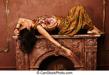 beauty sensual young woman in oriental style in luxury room...