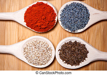Assortment of spices with milled dried hot pepper, sesame,...