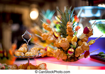 Diversity of pastry decorated with fruits and cookies at wedding