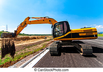 Excavator working on road construction site