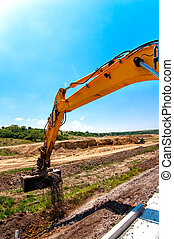 Close-up of excavator while working in road and highway...