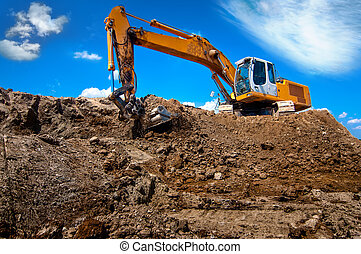 industrial excavator bulldozer in sandpit with raised bucket...
