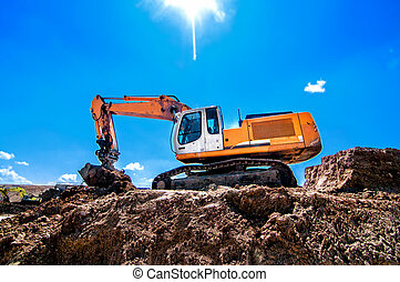 Industrial heavy duty excavator moving earth and soil on...