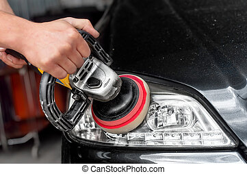 Car headlights cleaning with power buffer machine at car...