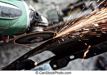 grinding through metal in steel factory