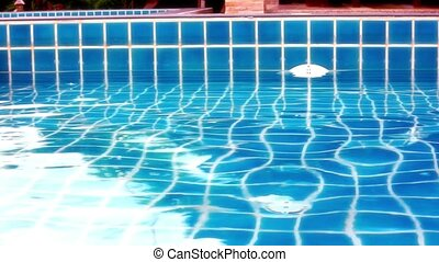 Shining blue water ripple in pool. Video shift motion...