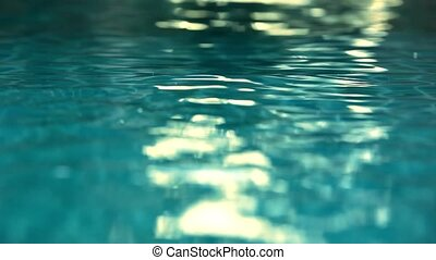 Shining blue water ripple in pool at sunset time Video shift...
