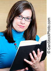 Woman Reading The Bible - Woman Wearing Glasses Holding And...