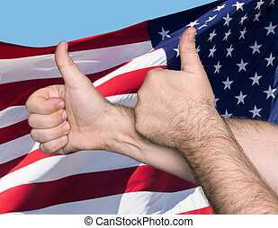 Thumbs up sign against of USA flag - Patriotic concept....