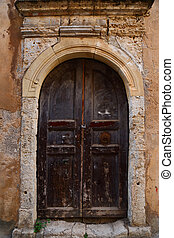 Weathered door on the old town of Chania, Crete island -...