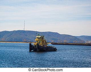Tugboat on river - Harbor tugboat on river
