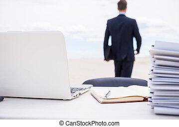 Tired of office life Rear view of man in formalwear walking...