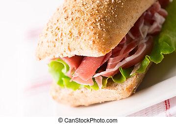 Prosciutto sandwich on plate macro
