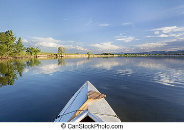 summer canoe paddling on lake