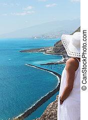 Girl lookng on Las Teresitas beach on Tenerife Island, Spain