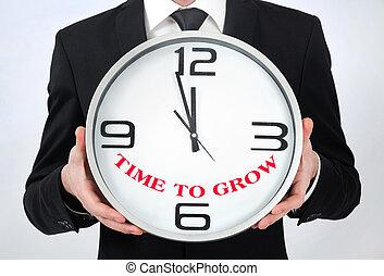 Man holding clock