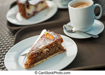 Freshly baked carrot cake with a cup of hot coffee