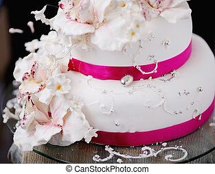 wedding cake decorated with creamy flowers