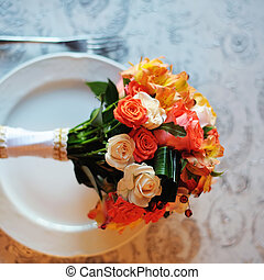 Bridal bouquet of various flowers on a served table in...