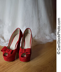 bridal shoes - red and sexy bridal shoes on a floor i