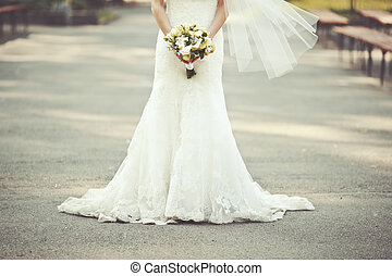 wedding dress, bride holding a bouquet